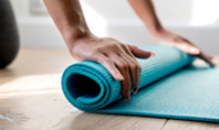 Young Yoga Woman Rolling Her Green Mat Presentation Presentation Template