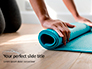 Young Yoga Woman Rolling Her Green Mat Presentation slide 1