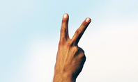 One Hand Making Peace Sign at Blue Sky Presentation Presentation Template