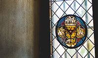 Stained Glass Window in Dark Room Presentation Presentation Template