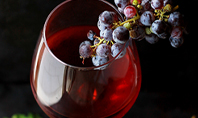 A Glass of Red Wine and Grapes Presentation Presentation Template