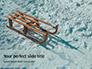 Wooden Sled on Snow Presentation slide 1