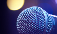 Close Up of Microphone in Concert Hall with Blurred Lights Presentation Presentation Template